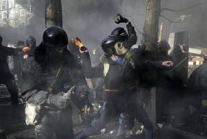 An anti-government protester throws a Molotov cocktail towards Interior Ministry members during clashes in Kiev
